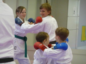 Partner exercises during karate class